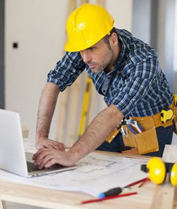 Construction worker on laptop
